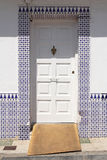 White door with spanish azulejos Stock Image