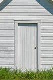 White Door in White Barn Stock Image