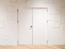 White door with white decorated wall Stock Photos
