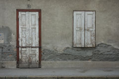 White door and a white vintage window closed Royalty Free Stock Image