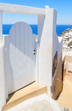 White doors against sea view at Oia town, Santorini, Greece Stock Photos