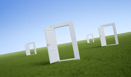 White doors in a field. Of grass Royalty Free Stock Photos