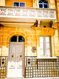 White Doors Gozo. White doors in gozo malta typical stone building with balcony royalty free stock photography