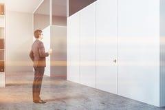 White doors in office interior, man stock photos