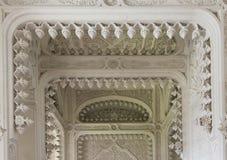 White Doorway close-up detail. REGGELLO, ITALY - MAY 2 2015: White Room inside the Sammezzano castle in Italy, in typical Moroccan Style. Doorway close-up detail Stock Photography