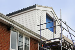 White Dormer. Looking up at White Dormer during construction Stock Photo