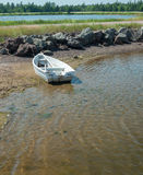 White dory on shore Royalty Free Stock Image