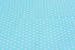 White dot on blue tablecloth Royalty Free Stock Image