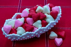 Candy Dish Valentine Candy Hearts. White dot candy dish, Valentine`s candy hearts. White background Copy space stock photography