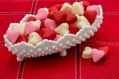 Candy Dish Valentine Candy Hearts. White dot candy dish, Valentine`s candy hearts. White background Copy space royalty free stock images