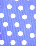 White dots, blue background Stock Photography