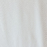 White dots on white fabric texture Stock Photos