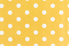 White dots on Yellow  Background. Yellow Fabric and White Polka Dots Background Royalty Free Stock Photography