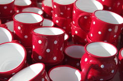 White dotted red cups Royalty Free Stock Image