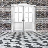 White double-leafed door of classical design in old brick wall. In grunge style stock images
