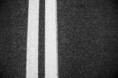 White double lines asphalt road background. Stock Photo