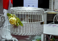White dove in a wicker basket ,cage. White wedding dove in a wicker basket in the form of a cage Stock Images