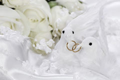 White doves with wedding rings Royalty Free Stock Images