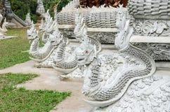White dragon around the church in thailand stock photo