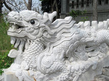White dragon figure. Asian white dragon figure, sculpture in buddhist pagoda. Ornaments, multicolored tiles decorated with beautiful fantastic dragon in the Stock Image