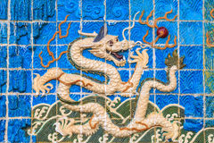 White dragon on the wall. Of a public Chinese temple. Dragon is commonly found in all Chinese architecture as it is a symbol of strength, power, and good Stock Images