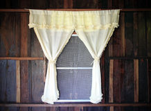 White drape and wooden window. White drape and old wooden window Stock Image