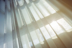 White drapery curtain hanging on the window Royalty Free Stock Image