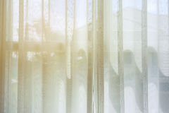 White drapery curtain hanging on the window Stock Photos