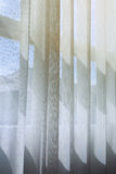 White drapery curtain hanging on the window Royalty Free Stock Photography