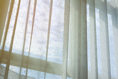White drapery curtain hanging on the window. Interior decoration home, white drapery curtain hanging on the window with sun light in the morning day Stock Photography