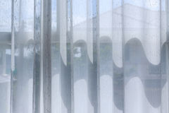 White drapery curtain hanging on the window Stock Photography