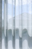 White drapery curtain hanging on the window Royalty Free Stock Images