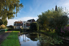 White drawbridge in the idyllic village of Marken Royalty Free Stock Image