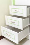 3 white drawer with some green line Royalty Free Stock Photo