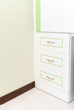 3 white drawer with some green line Royalty Free Stock Photography