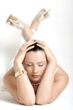 White Dream. A young woman lying on the floor in white with closed eyes Royalty Free Stock Images
