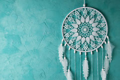 White  dream catcher. White dream catcher on turquoise textured background. Texture of concrete Stock Photography