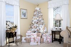 White Dreamy Christmas Tree decorated in Blush Pink Ornaments. White dreamy Christmas Tree decorated in blush pink, gold and white ornaments. Below are gifts royalty free stock photography