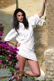 In a white dress. The model was wearing a white dress. She was acting expressions Royalty Free Stock Photography