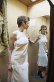 White dress in a changing room. Caucasian woman trying a white dress in a changing room Stock Images