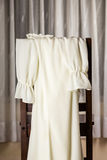 White dress draped over chair Royalty Free Stock Photography