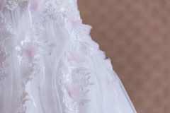 White dress lace. Lace on white dress trail Royalty Free Stock Images
