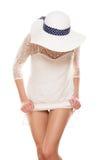 In white dress lifting skirt Stock Image