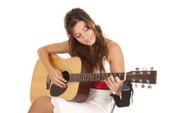White dress play guitar Royalty Free Stock Images