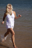 White dress run in water Royalty Free Stock Photography