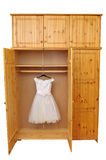 White dress in wooden wardrobe Royalty Free Stock Image