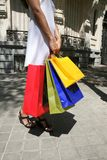 White dressed female with shopping bags Stock Photos
