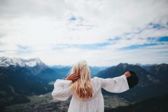 White Dressed Girl Across Black Mountains Royalty Free Stock Photo