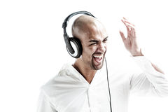 White dressed man having fun with music Royalty Free Stock Photography