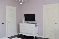 White dresser in a bedroom. Stock Images